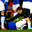 STEVENAGE, ENGLAND - JANUARY 25:  Bryan Oviedo of Everton lies on the ground as he receives treatmen