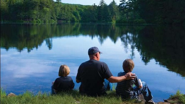 man fishing wit kids