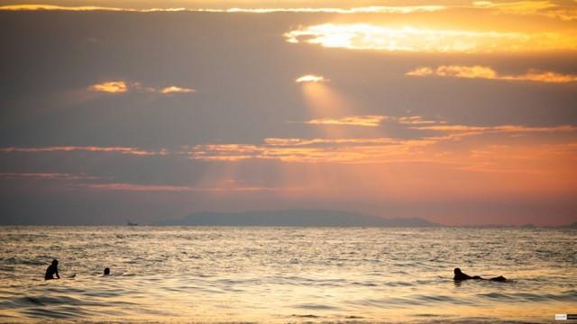 scott alexander surfing at sunset