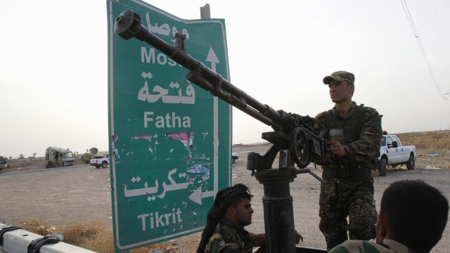 Members of the Kurdish security forces take part in an intensive security deployment on the outskirts of Kirkuk