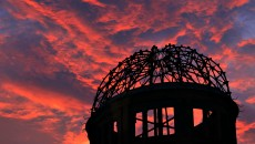 The Atomic Bomb Dome is silhouetted at sunset in Hiroshima, west