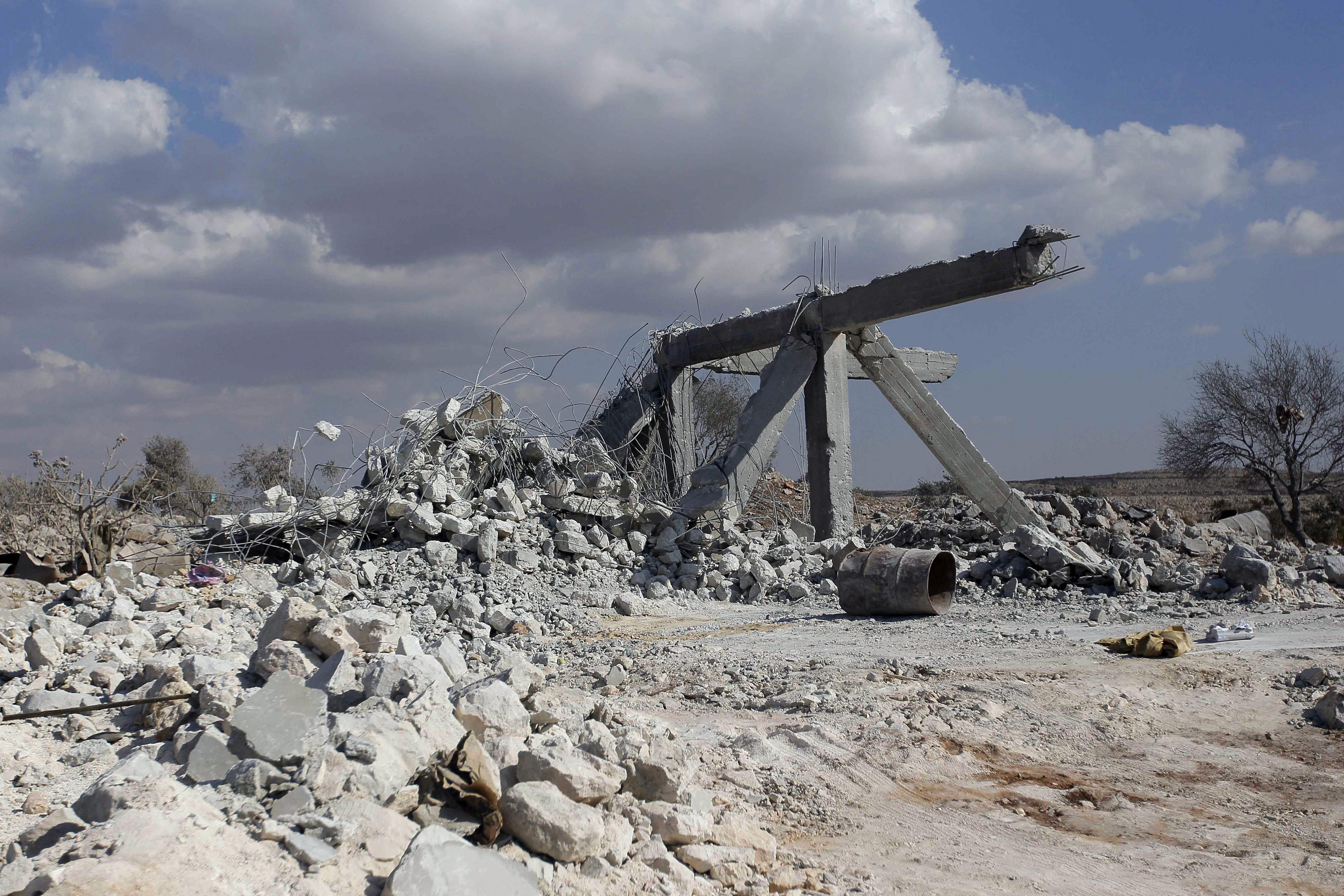 A damaged site is seen in what activists say was a U.S. strike, in Kfredrian