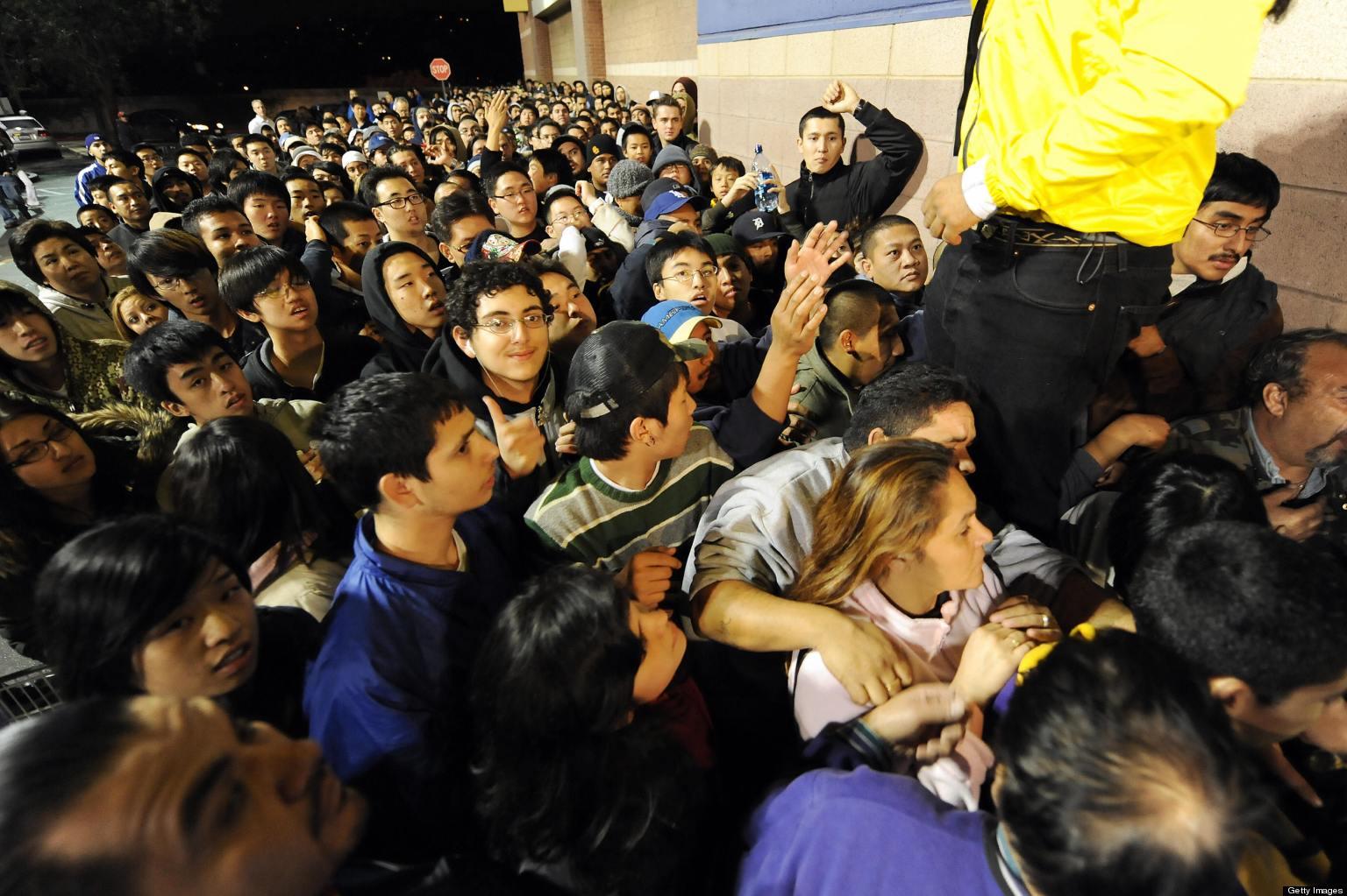 Shoppers wait outside a Best Buy store t