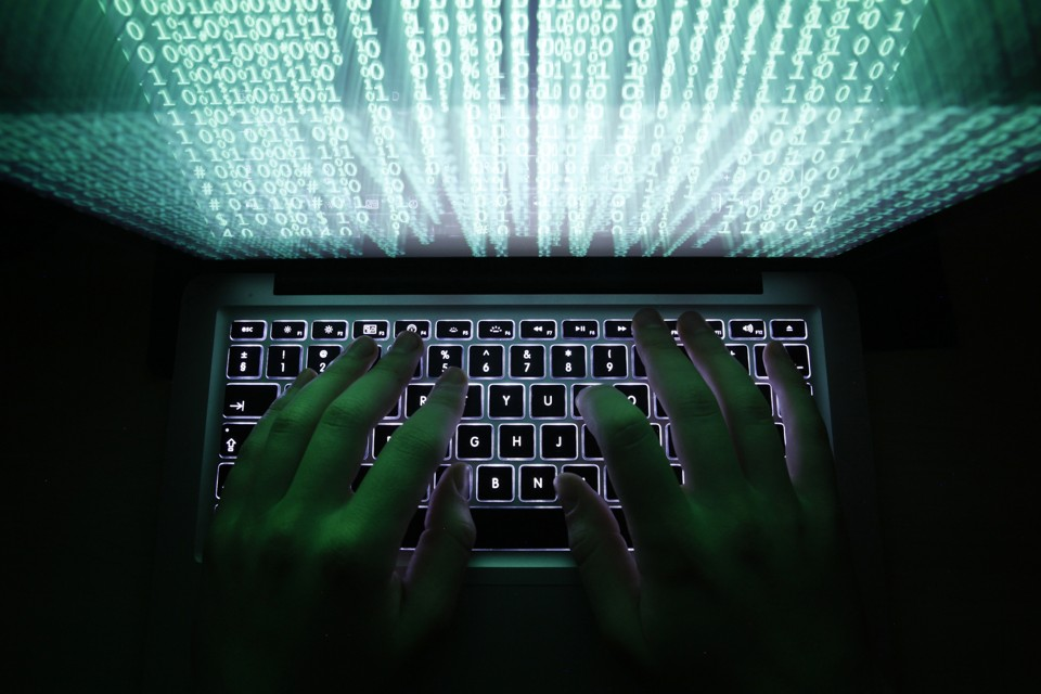 """A man types on a computer keyboard in Warsaw in this February 28, 2013 illustration file picture. One of the largest ever cyber attacks is slowing global internet services after an organisation blocking """"spam"""" content became a target, with some experts saying the disruption could get worse. To match INTERNET-ATTACK/ REUTERS/Kacper Pempel/Files (POLAND - Tags: BUSINESS SCIENCE TECHNOLOGY) - RTXXZVX"""