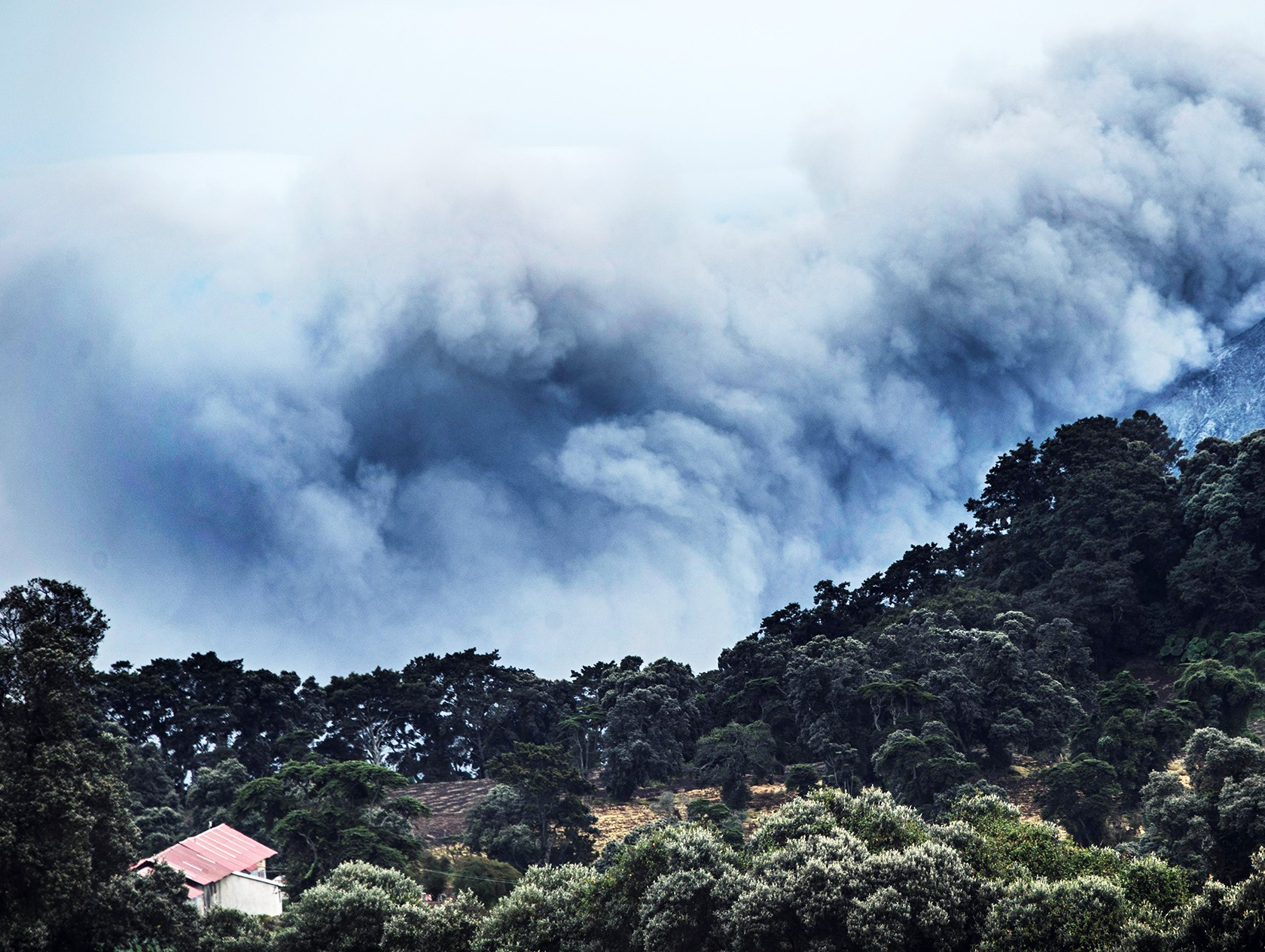 View of the Turrialba volcano on September 20, 2016 in Cartago, 46 km from San Jose.  The Costa Rican authorities suspended operations at the country's main airport Monday after the nearby Turrialba volcano erupted, sending a thick ash cloud into the sky. Turrialba erupted twice Monday, first at dawn and again just before noon. The second eruption sent an ash cloud 4,000 meters  / AFP / Ezequiel Becerra        (Photo credit should read EZEQUIEL BECERRA/AFP/Getty Images)