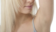 Portrait of pretty woman looking her clean fresh armpit; Shutterstock ID 48291592; PO: TODAY.COM