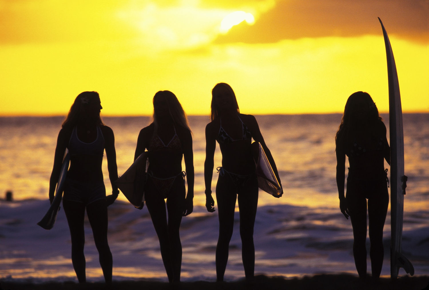 silhouetted surfer girls, Waimea Bay, north shore, 1996