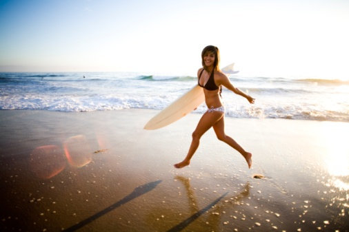 A surfer girl poses for fun portraits in San Diego, CA